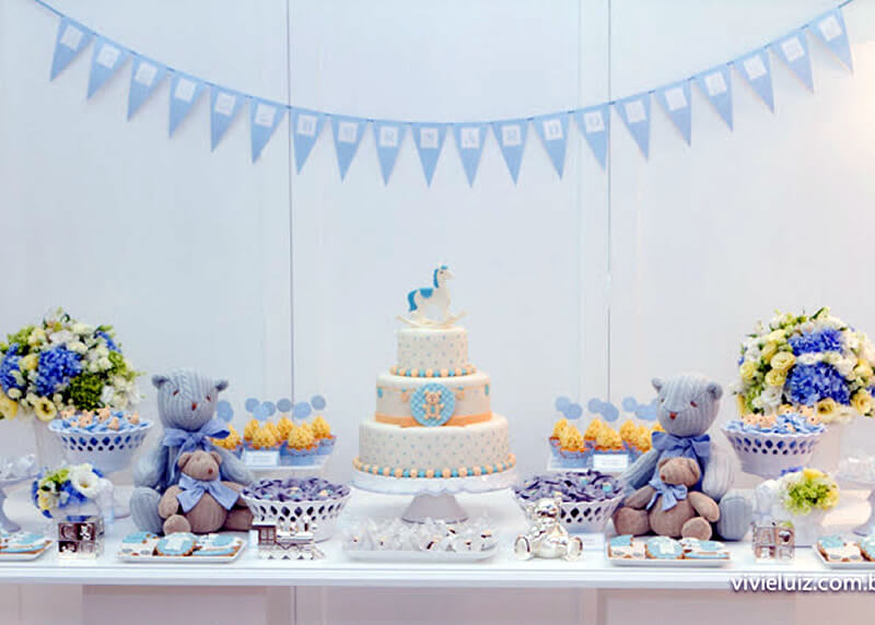 Blue and white baby shower truffle wrappers table settings Baby shower table setting